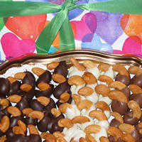 Hand-Dipped Cashews: Jumbo roasted Brazilian cashews, dipped in creamy chocolate